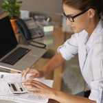 small business owner calculates tax